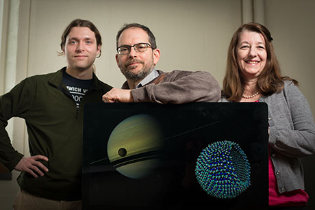 James Stevenson, Jonathan Lunine and Paulette Clancy with graphic